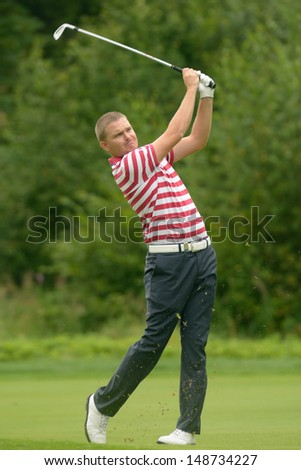 MOSCOW, RUSSIA - JULY 28: James Morrison of England in action during final round of the M2M Russian Open at Tseleevo Golf & Polo Club in Moscow, Russia on July 28, 2013 - stock photo