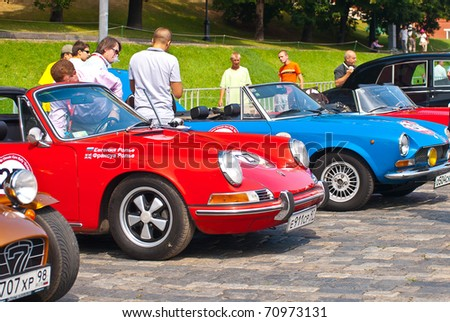 """MOSCOW,RUSSIA-JULY 10: Oldtimer sport cars on display at the start annual Rally of classical cars  """"Zolotoe kol'co"""" on Red Square on July 10, 2010 in Moscow, Russia - stock photo"""