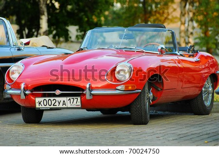 MOSCOW, RUSSIA-JULY 31: Red Jaguar E-Type. Modelyear 1963, on exhibition parking at annual 'Night Moscow Classic Rally'. The sixth race of vintage cars, more than 50 crews, from owners to showstars - stock photo