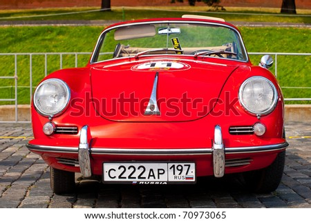 """MOSCOW,RUSSIA-JULY 10: Red Porsche-Convertible-D-1958 on display at the start annual Rally of classical cars  """"Zolotoe kol'co"""" on Red Square on July 10, 2010 in Moscow, Russia - stock photo"""