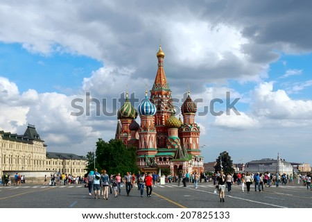 MOSCOW, RUSSIA -JULY 5, 2014:  Tourists visiting the St. Basil's Cathedral  on Red Square, on july 5, 2014 in Moscow. St. Basil's Cathedral is a famous monument of Russian culture. - stock photo