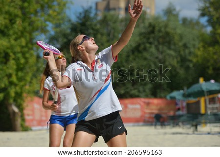 MOSCOW, RUSSIA - JULY 19, 2014: Woman double of Russia in the match against Italy during ITF Beach Tennis World Team Championship. Italy won in two sets - stock photo