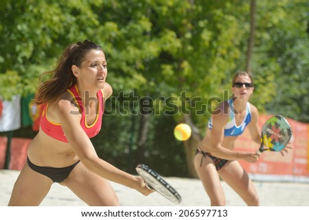 MOSCOW, RUSSIA - JULY 20, 2014: Women double of Spain in the match for the 5th place against Venezuela during ITF Beach Tennis World Team Championship. Spain won 2-0 - stock photo