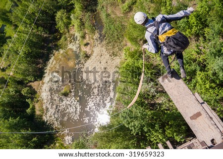 MOSCOW, RUSSIA - June 3, 2007 - Athlete performing a jump. Group of rope jumpers organize such events for people seeking to bring a dose of adrenaline in their life - stock photo