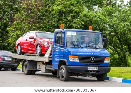MOSCOW, RUSSIA - JUNE 2, 2012: Blue tow truck Mercedes-Benz Vario 614D at the city street. - stock photo
