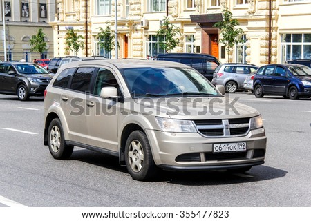 MOSCOW, RUSSIA - JUNE 2, 2013: Motor car Dodge Journey in the city street. - stock photo
