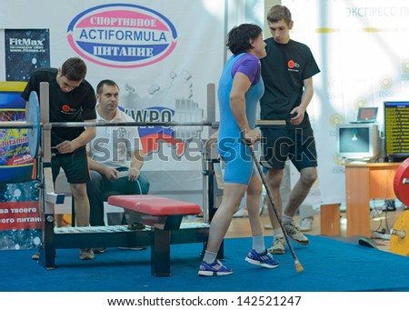 MOSCOW, RUSSIA - JUNE 13: participation of persons with disabilities in action during the Russian championship on powerlifting event in Moscow on June 13, 2013. - stock photo