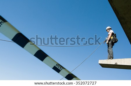 MOSCOW, RUSSIA - June 3, 2007 - People at extreme sports Ropejumping event. Group of rope jumpers organize such events for people seeking to bring a dose of adrenaline in their life - stock photo