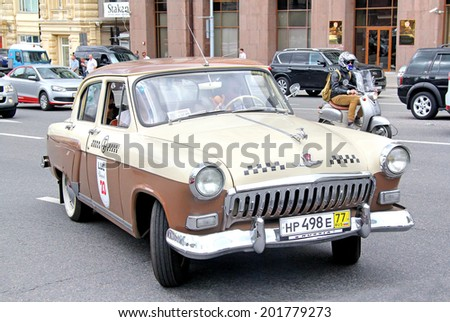 MOSCOW, RUSSIA - JUNE 2, 2013: Soviet motor car GAZ-21 Volga competes at the annual L.U.C. Chopard Classic Weekend Rally. - stock photo