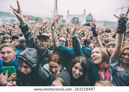 MOSCOW, RUSSIA - JUNE 29, 2014 - Visitors at Park Live festival at at the National Exhibition Centre on June 29, 2014 in Moscow, Russia. Toned picture - stock photo