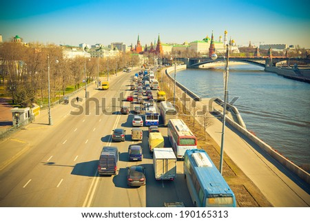 Moscow, Russia, Kremlin Embankment and Big Stone Bridge. Traffic jams in the direction of the city center. Photo tinted yellow - stock photo
