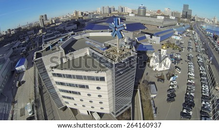 MOSCOW, RUSSIA - MAR 12, 2013: Cityscape with Expo Center exhibition complex at sunny day. Aerial view - stock photo