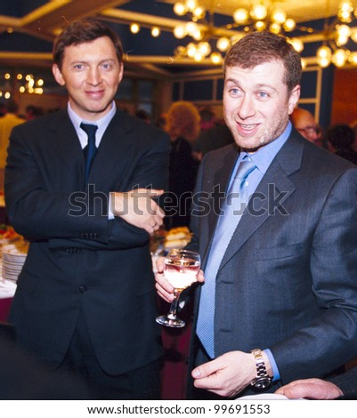 MOSCOW, RUSSIA - MAR 29: Russian oligarch Oleg Deripaska, left, and Roman Abramovich, attend a meeting between Russian president Vladimir Putin and Russian businessmen in the Kremlin on Wednesday, March 29, 2006. - stock photo