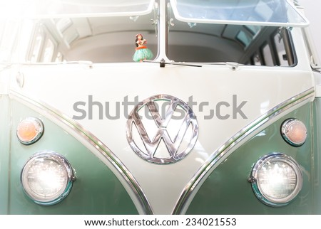Moscow, Russia - March 3, 2013: Front view of a green and white 1960s VW campervan with the iconic volkswagen badge and double windshield. - stock photo