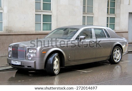 MOSCOW, RUSSIA - MARCH 8, 2015: Grey luxury car Rolls-Royce Phantom at the city street. - stock photo
