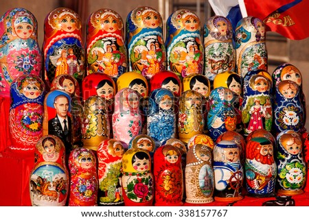 MOSCOW, RUSSIA - March 31, 2008. Russian traditional nested dolls - matryoshka. Some dolls have a portrait of V. V. Putin, the Russian president. Dolls are on sale as souvenirs for tourists. - stock photo
