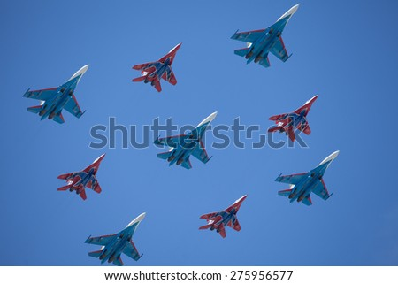 MOSCOW, RUSSIA - MAY 7, 2015: A group of airplane. Rehearsal of parade devoted to May 9, 70-th Victory Day in World War II. May 7, 2015 in Moscow. - stock photo