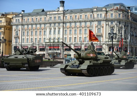 "MOSCOW, RUSSIA - MAY 07, 2015:A new IFV T-15 ""Armata"" on medium tracked platform and tank T-34-85 during the rehearsal of the parade dedicated to the 70th anniversary of the Victory. - stock photo"