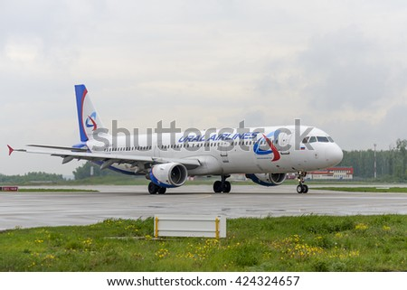 MOSCOW, RUSSIA - MAY 19, 2016: Airbus A321 Ural Airlines taxiing. Plane makes taxiing on taxiway Domodedovo International Airport. - stock photo