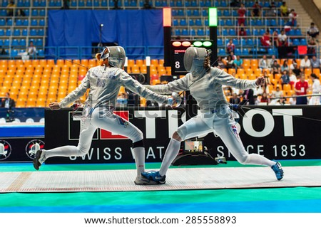MOSCOW, RUSSIA - MAY 31 2015: Alexandra Shatalova and Sage Palmedo fights on the World  fencing Grand Prix Moscow Saber in Luzhniki sport palace - stock photo