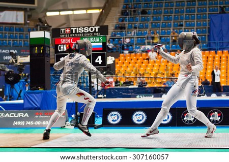 MOSCOW, RUSSIA - MAY 31 2015: C. Shen and S. Velikaya fights on the World  fencing Grand Prix Moscow Saber in Luzhniki sport palace - stock photo