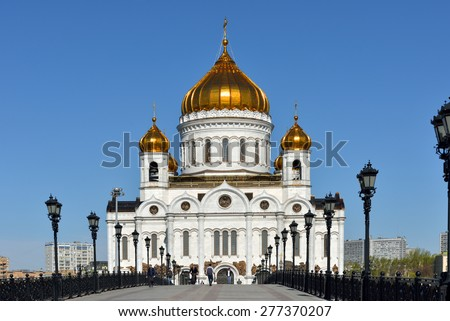 MOSCOW, RUSSIA - MAY 4, 2014:Cathedral of Christ Saviour is tallest Orthodox Christian church in world. Original church built during 19th century, church was reconstructed in the 1990s on same site. - stock photo