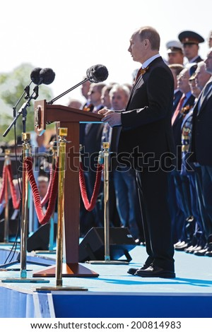 MOSCOW, RUSSIA - MAY 09, 2014: Celebration of the 69th anniversary of the Victory Day (WWII) on Red Square. President Vladimir Putin congratulates the audience - stock photo