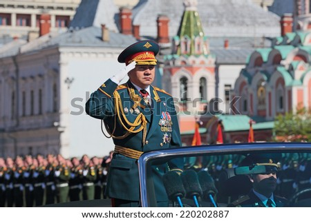 MOSCOW, RUSSIA - MAY 09, 2014: Celebration of the 69th anniversary of the Victory Day (WWII) on Red Square. The parade will be attended by Minister of defence of the Russian Federation Sergey Shoygu - stock photo