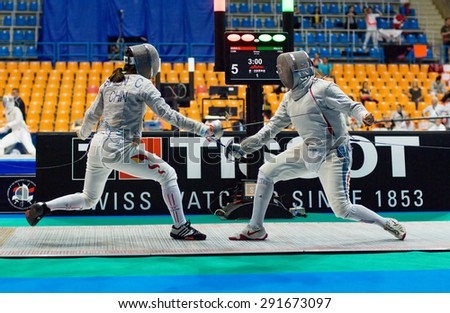 MOSCOW, RUSSIA - MAY 31 2015: Chen Shen vs Flora Palu during the World  fencing Grand Prix Moscow Saber in Luzhniki sport palace - stock photo
