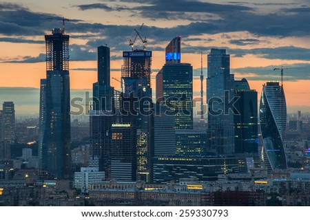 MOSCOW, RUSSIA - MAY 24, 2014: Cityscape of skyscrapers of Moscow City business complex and sunset. Moscow International Business Center Moscow City includes 20 futuristic buildings - stock photo