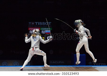 MOSCOW, RUSSIA - MAY 31 2015: E. Dyachenko (L) vs Y. Egorian (R) on final during the World  fencing Grand Prix Moscow Saber in Luzhniki sport palace - stock photo