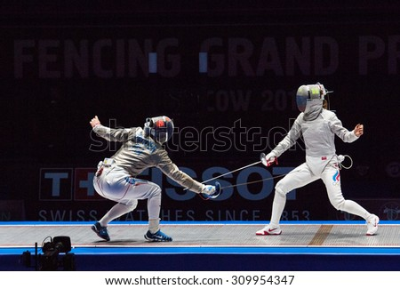 MOSCOW, RUSSIA - MAY 31 2015: Ekaterina Dyachenko and Cecilia Berder fights on the World  fencing Grand Prix Moscow Saber in Luzhniki sport palace - stock photo