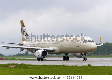 MOSCOW, RUSSIA - MAY 19, 2016: Etihad airlines Airbus A321. Plane makes taxiing on taxiway Domodedovo International Airport. Rainy and cloudy day. - stock photo
