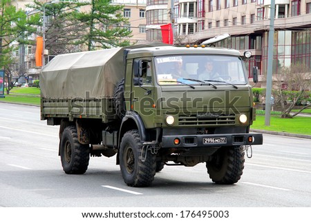 MOSCOW, RUSSIA - MAY 6, 2013: Green russian military truck KAMAZ 4350 Mustang at the city street. - stock photo