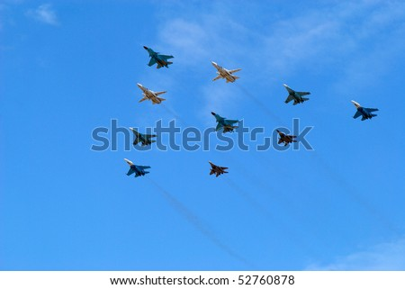 MOSCOW, RUSSIA - MAY 9: Group of planes flies against the blue sky on May 9, 2010 in Moscow, Russia - stock photo