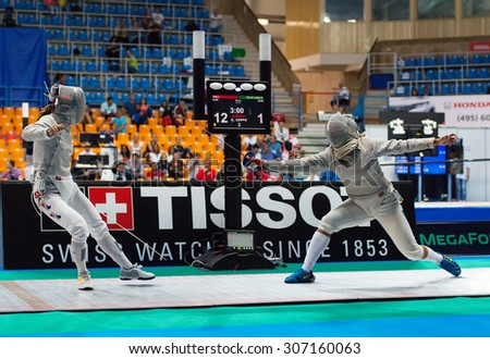 MOSCOW, RUSSIA - MAY 31 2015: J. Kim vs L. Felix on the World  fencing Grand Prix Moscow Saber in Luzhniki sport palace - stock photo