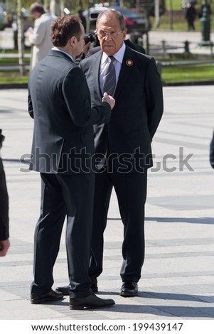 MOSCOW, RUSSIA - MAY 8, 2014: Minister of foreign Affairs of the Russian Federation Sergey Lavrov at the ceremony of laying flowers to the Tomb of the Unknown Soldier - stock photo