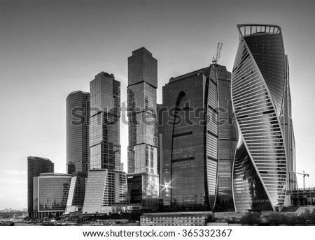 Moscow, Russia - May 22, 2015: Moscow-city at evening (Moscow International Business Center) against the backdrop of the sunset sky in black and white, Moscow, Russia. - stock photo