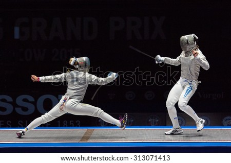 MOSCOW, RUSSIA - MAY 31 2015: O. Kharlan (L) and V. Vougiouka (R) just before finals on the World  fencing Grand Prix Moscow Saber in Luzhniki sport palace - stock photo