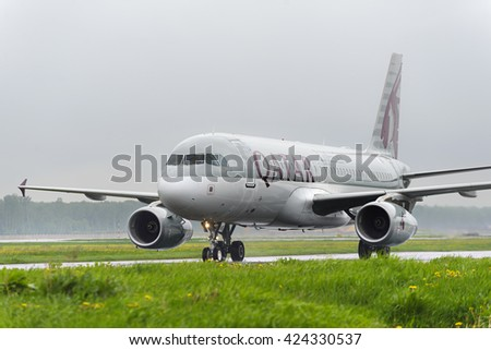 MOSCOW, RUSSIA - MAY 19, 2016:Qatar airlines Airbus A320 taxiing. Plane makes taxiing on taxiway Domodedovo International Airport. Rainy and cloudy day. - stock photo
