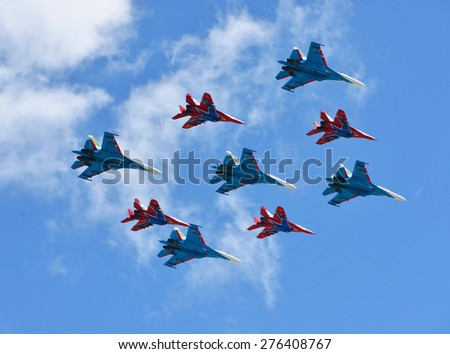 MOSCOW, RUSSIA - MAY 5, 2015:Rehearsal For Victory Parade which will take place in Red Square on 9 May 2015 to commemorate 70th anniversary of capitulation of Nazi Germany in 1945. MiG-29 and Su-27 - stock photo
