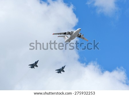 MOSCOW, RUSSIA - MAY 5, 2015:Russian Air Force IL-78 air-to-air refueling tanker demonstrates in-flight refueling of Mikoyan MiG-31 strategic bomber during rehearsal for Victory Day military parade - stock photo