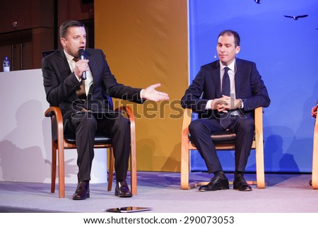 MOSCOW, RUSSIA - MAY 17, 2011: Russian TV director Leonid Parfenov (left) and  SAP Russia CEO Vladislav Martynov make panel discussion at SAP Forum 2011 conference on May 17, 2011 in Moscow, Russia.