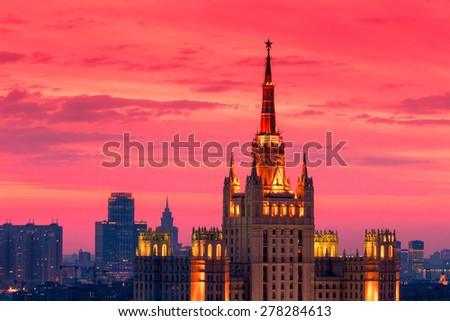 Moscow, Russia, 09 May 2015: Stalin skyscraper building with star on spire in Moscow center at red sunset - stock photo