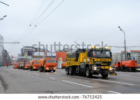 MOSCOW, RUSSIA - MAY 07: Street cleansing machines wash the asphalt road before the Victory day military Parade May 07, 2011 in Moscow, Russia. - stock photo