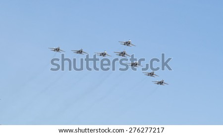 MOSCOW/RUSSIA - MAY 7: 8 Sukhoi Su-30SM (Flanker-C) and Su-35 (Flanker-E) twin-engined supermaneuverable fighters on rehearsal of parade devoted to Victory Day aniversary on May 7, 2015 in Moscow. - stock photo