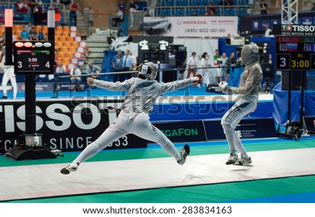 MOSCOW, RUSSIA - MAY 31 2015: Svetlana Kormilitsyna and Sara Balzer fights on the World  fencing Moscow Sabre Grand Prix in Luzhniki sport palace - stock photo