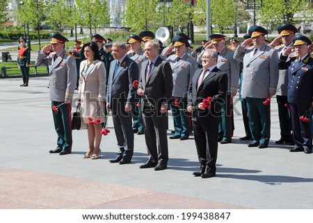 MOSCOW, RUSSIA - MAY 8, 2014: The leadership of the Ministry of defense of the ceremony of laying flowers to the Tomb of the Unknown Soldier. Festive events dedicated Anniversary of Victory Day (WWII) - stock photo