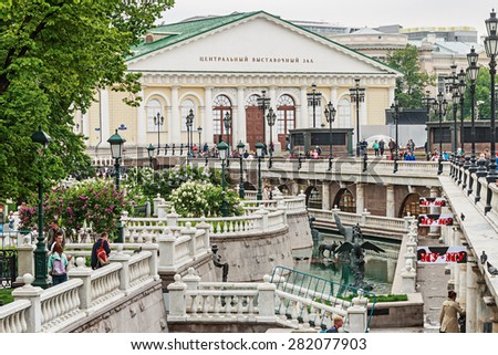 Moscow, Russia - May 23, 2015: tourists in the Alexander Garden fountains. Alexandrovsky Garden Park in the center of Moscow was founded in 1812 on the site of the river Neglinnaya - stock photo