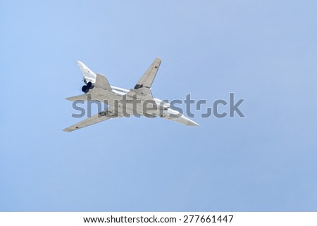 MOSCOW/RUSSIA - MAY 7: Tupolev Tu-22M3 (Backfire) supersonic swing-wing long-range strategic and maritime strike bomber fllies on rehearsal of parade devoted to Victory Day on May 7, 2015 in Moscow. - stock photo